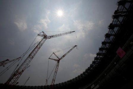 Construction site of the New National Stadium, the main stadium of Tokyo 2020 Olympics and Paralympics, is seen under the light of the sun during a heat wave in Tokyo, Japan July 18, 2018. REUTERS/Issei Kato
