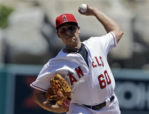 Los Angeles Angels starter Jason Vargas pitches to the Chicago White Sox in the first inning of a baseball game in Anaheim, Calif., Sunday, May 19, 2013. (AP Photo/Reed Saxon)