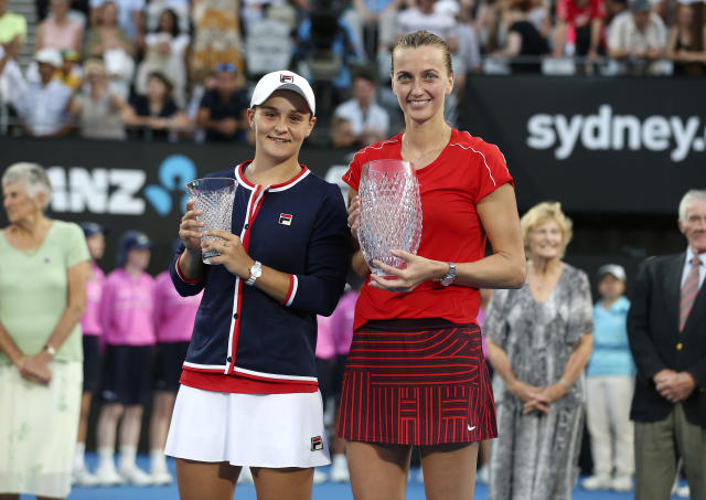 Petra Kvitova of the Czech Republic, right, holds the winner's trophy as she poses for photographers with runner up Ashleigh Barty of Australia after their women's final match at the Sydney International tennis tournament in Sydney, Australia, Saturday, Jan. 12, 2019. (AP Photo/David Moir)