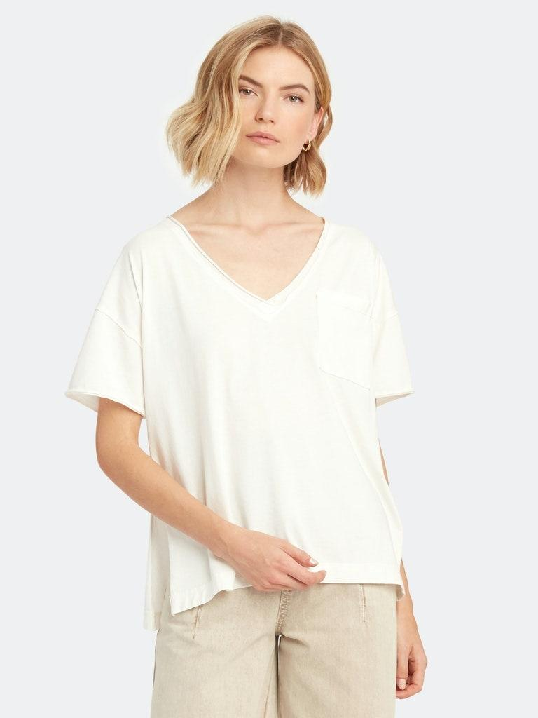 """The exaggerated neckline makes this boxy Free People tee extra cozy-looking. Skip the sweats and wear it with <a href=""""https://www.glamour.com/story/comfortable-jeans-quarantine?mbid=synd_yahoo_rss"""" rel=""""nofollow noopener"""" target=""""_blank"""" data-ylk=""""slk:your stretchiest denim"""" class=""""link rapid-noclick-resp"""">your stretchiest denim</a>. $68, Verishop. <a href=""""https://www.verishop.com/free-people/tops/want-you-boxy-tee/p4341684699159?color=ivory"""" rel=""""nofollow noopener"""" target=""""_blank"""" data-ylk=""""slk:Get it now!"""" class=""""link rapid-noclick-resp"""">Get it now!</a>"""