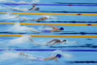 Swimmers compete in a heat of the men's 800-meter freestyle at the 2020 Summer Olympics, Tuesday, July 27, 2021, in Tokyo, Japan. (AP Photo/Charlie Riedel)