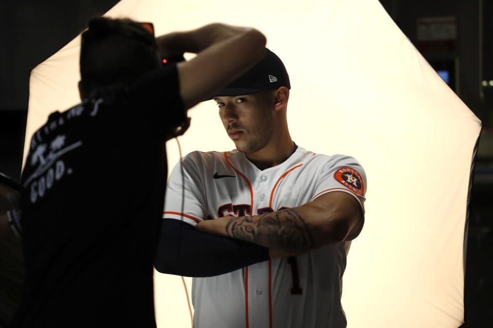 Houston Astros' Carlos Correa poses during photo day before a spring training baseball practice Tuesday, Feb. 18, 2020, in West Palm Beach, Fla. (AP Photo/Jeff Roberson)