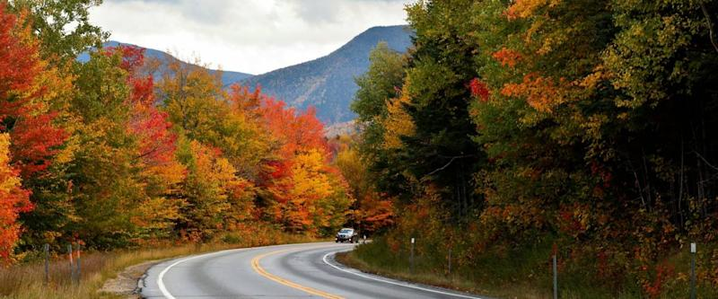 Beautiful fall foliage along the famous Kancamagus Highway at White Mountain, New Hampshire, USA