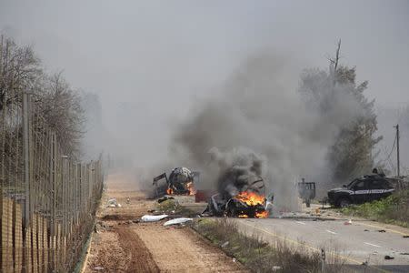 Burning vehicles are seen near the village of Ghajar on Israel's border with Lebanon, January 28, 2015. A Hezbollah missile strike wounded four Israeli soldiers on Wednesday, the biggest attack on Israeli forces by the Lebanese guerrilla group since a 34-day war in 2006. REUTERS/Maruf Khatib