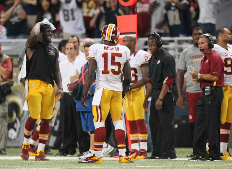 The Washington Redskins sideline including head coach Mike Shanahan, right,  reacts after wide receiver Joshua Morgan (15) picked up an unsportsmanlike conduct penalty for throwing the ball at an opposing player during the fourth quarter action against the St. Louis Rams in an NFL football game  on Sunday, Sept. 16, 2012 at the Edward Jones Dome in St. Louis. (AP Photo/St. Louis Post-Dispatch, Chris Lee)  EDWARDSVILLE INTELLIGENCER OUT; THE ALTON TELEGRAPH OUT