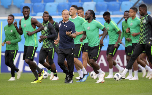 Nigeria head coach Gernot Rohr, centre, runs with his players during Nigeria's official training in St.Petersburg, Monday, June 25, 2018 on the eve of the group D match between Nigeria and Argentina at the 2018 soccer World Cup in the Saint Petersburg Arena. (AP Photo/Dmitri Lovetsky)