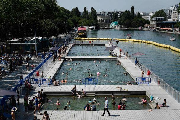 PHOTO: People cool off at floating pools set up on the Ourcq canal in Paris on July 25, 2019, as a new heatwave hits Europe. (Philippe Lopez/AFP/Getty Images)