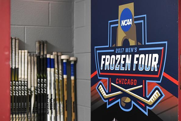 """CHICAGO, IL – APRIL 06: A logo is seen on a door next to hockey sticks prior to an NCAA Frozen Four semifinal game with the Harvard Crimson and the <a class=""""link rapid-noclick-resp"""" href=""""/ncaab/teams/minnesota_duluth/"""" data-ylk=""""slk:Minnesota-Duluth Bulldogs"""">Minnesota-Duluth Bulldogs</a> on April 6, 2017, at the United Center in Chicago, IL. (Photo by Patrick Gorski/Icon Sportswire via Getty Images)"""