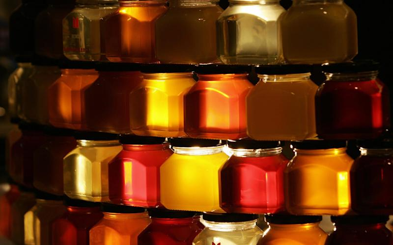 Sweetness and light: jars of honey on display at a sustainable food festival in Turin - FILIPPO MONTEFORTE/AFP via Getty