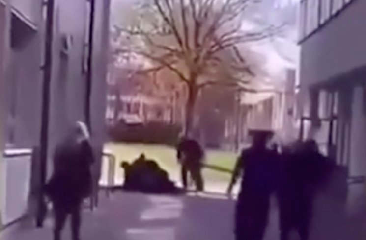 Video footage captured a man being pinned to the ground after reports of gunshots at Crawley College, West Sussex, on Monday. (Yahoo News UK)