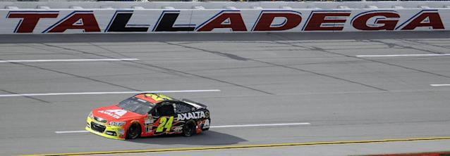 Driver Jeff Gordon races through the tri-oval during practice for Sunday's NASCAR Sprint Cup Series auto race at Talladega Superspeedway in Talladega, Ala., Friday, Oct. 18, 2013.(AP Photo/Dave Martin)