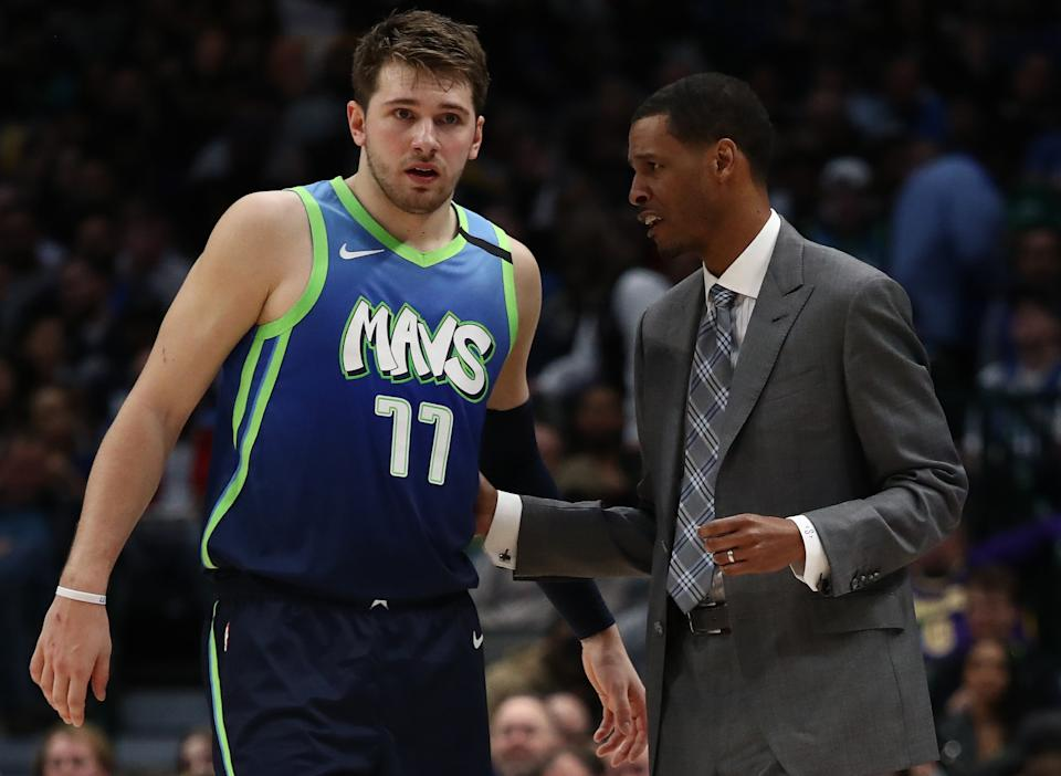 DALLAS, TEXAS - JANUARY 10:   Luka Doncic #77 of the Dallas Mavericks and assistant coach Stephen Silas at American Airlines Center on January 10, 2020 in Dallas, Texas.  NOTE TO USER: User expressly acknowledges and agrees that, by downloading and or using this photograph, User is consenting to the terms and conditions of the Getty Images License Agreement.  (Photo by Ronald Martinez/Getty Images)