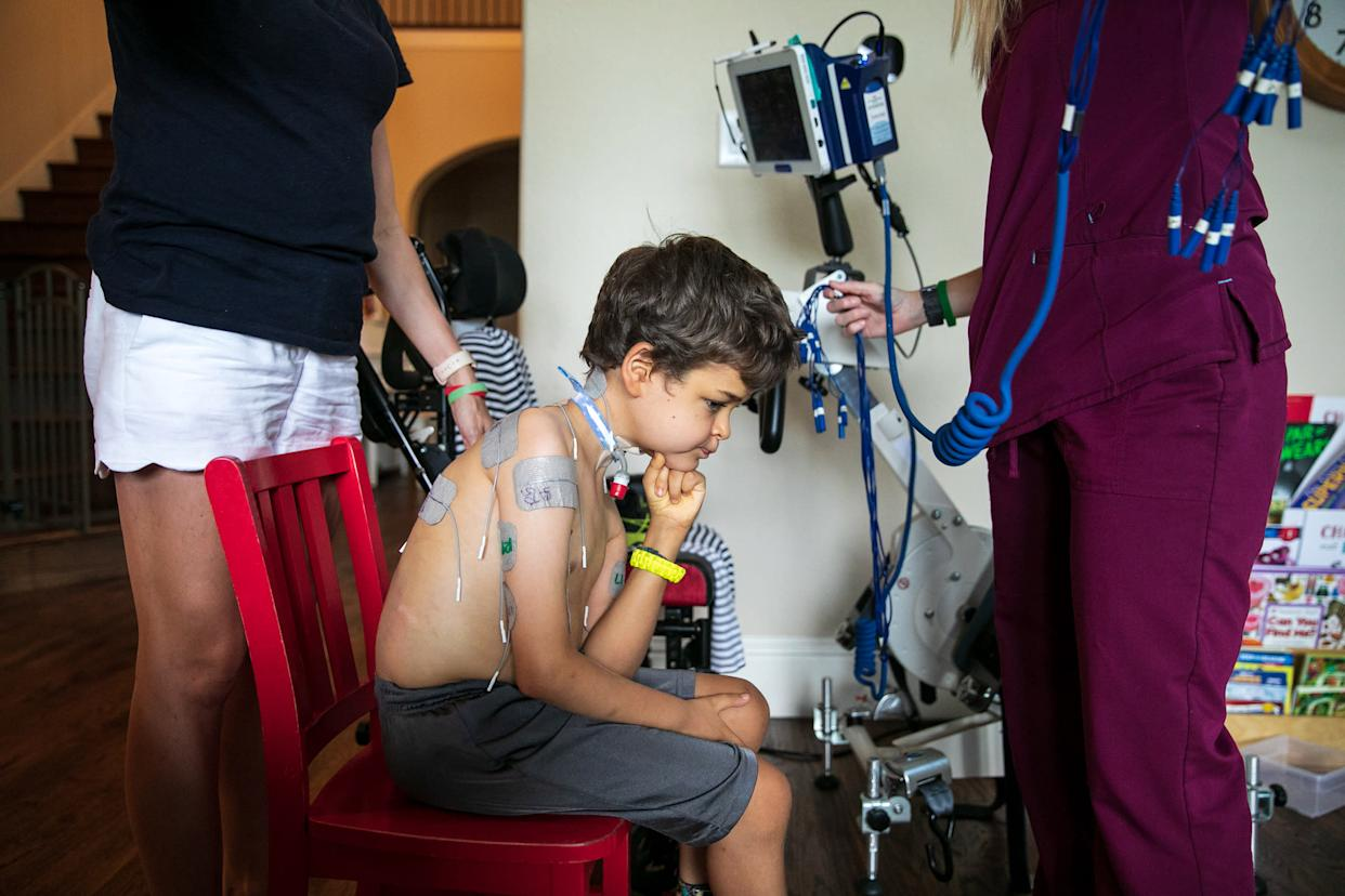 Braden's nurse and mother set him up for treatment. | Ilana Panich-Linsman for TIME
