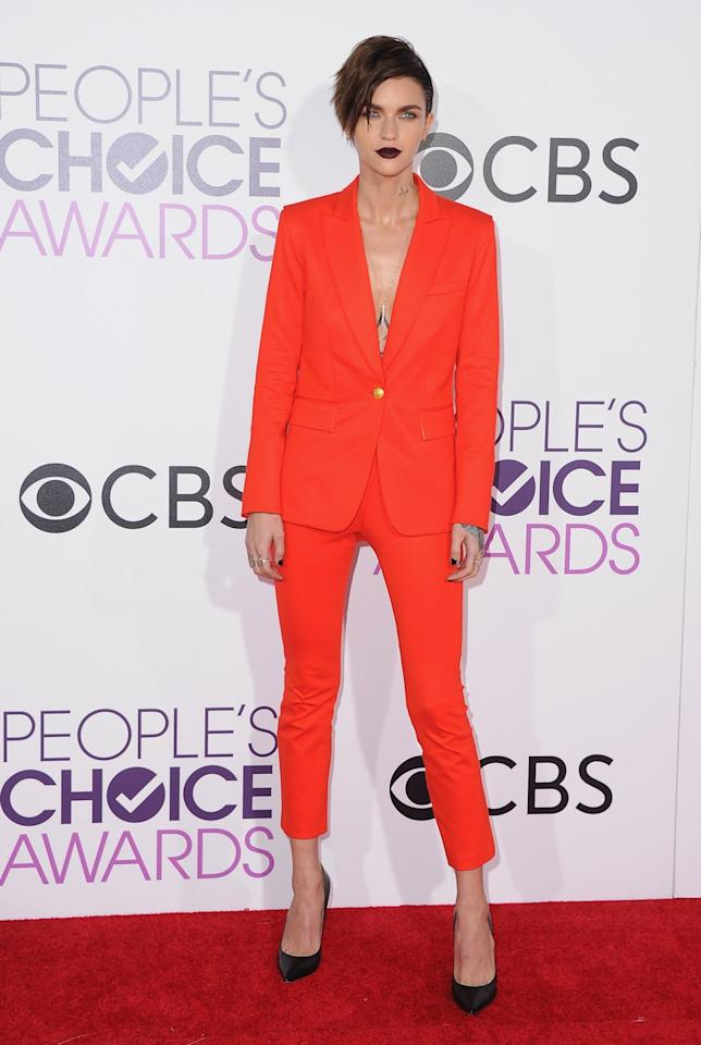 <p>We are obsessed with this look, from the red Veronica Beard suit, to vampy dark lipstick. [Photo: Getty] </p>
