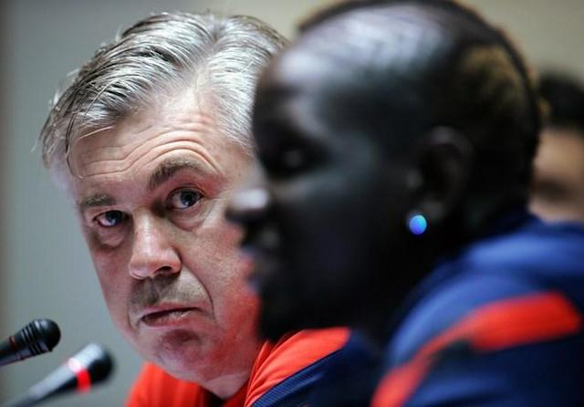 New coach of the Paris Saint-Germain League 1 football club Carlo Ancelotti (L) listens as captain Mamadou Sakho speaks at a press conference at the Aspire complex in the Qatari capital Doha on January 3, 2012. PSG will face Italian champions AC Milan in the Challenge Cup on January 4 in Dubai. (Photo by Franck Fife/AFP/Getty Images)