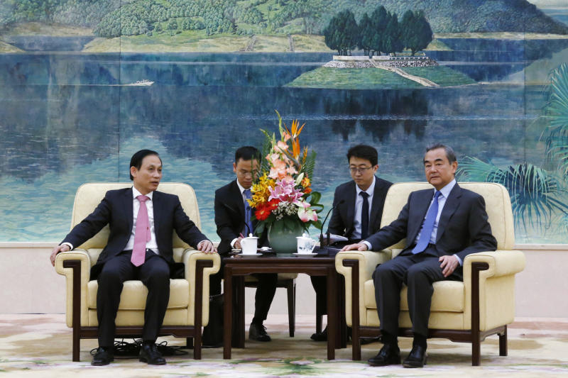FILE - In this Nov. 27, 2019, file photo, Vietnam's Deputy Foreign Minister Le Hoai Trung, left, attends a meeting with Chinese Foreign Minister Wang Yi at the Great Hall of the People in Beijing. Leading diplomats from Vietnam and China sought to patch up relations after a new round of tensions over China's oil exploration activities in waters claimed by Hanoi. (Florence Lo/Pool Photo via AP, File)
