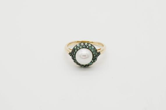 "<br><br><strong>DamatiJewelry</strong> 14k Natural Pearl & Alexandrite Flower Ring, $, available at <a href=""https://go.skimresources.com/?id=30283X879131&url=https%3A%2F%2Fwww.etsy.com%2Flisting%2F853306732%2F14k-natural-pearl-alexandrite-flower"" rel=""nofollow noopener"" target=""_blank"" data-ylk=""slk:Etsy"" class=""link rapid-noclick-resp"">Etsy</a>"