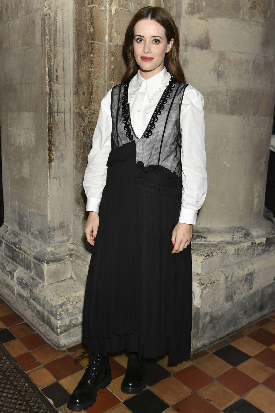 <p><strong>20 September </strong></p><p>Claire Foy layered a sheer dress over a crisp white shirt for the show. </p>