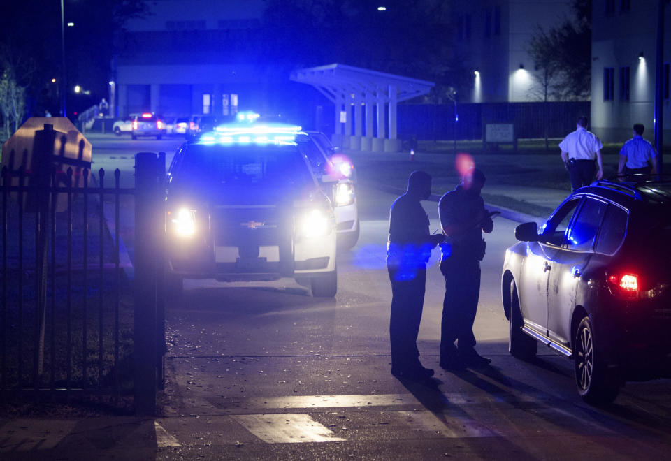 New Orleans police investigate after the fatal shooting of a police officer at George Washington Carver High School where a basketball game was being played, Friday, Feb. 26, 2021, in New Orleans. (Max Becherer/The Times-Picayune/The New Orleans Advocate via AP)