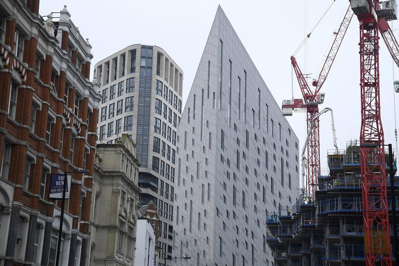 Construction work is seen amongst residential and commercial buildings in east London
