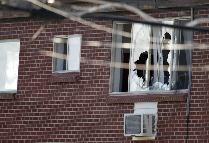 """Windows are broken at the apartment of the alleged gunman James Holmes, 24, Friday, July 20, 2012 in Aurora, Colo. Authorities report that 12 died and more than three dozen people were shot during an assault at the theatre during a midnight premiere of """"The Dark Knight. (AP Photo/Alex Brandon)"""