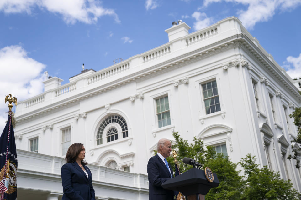 FILE - In this May 13, 2021, file photo Vice President Kamala Harris listens as President Joe Biden speaks about updated guidance on mask mandates, in the Rose Garden of the White House in Washington. Thanks to growing availability of the coronavirus vaccine and a recent relaxation of federal guidance on masks and distancing, the Biden administration is embracing the look and feel of pre-pandemic days on Pennsylvania Avenue. (AP Photo/Evan Vucci, File)