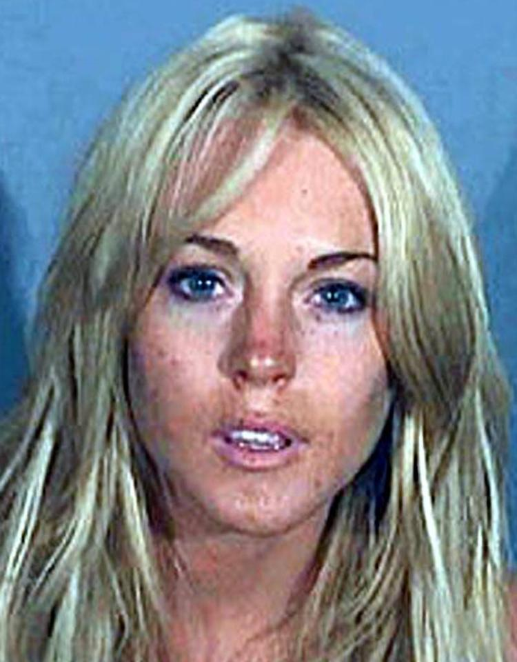 "Alas, less than two weeks after leaving rehab, the troubled starlet was busted for driving under the influence and drug possession on July 24, 2007. <a href=""http://www.x17online.com"" target=""new"">X17 Online</a> - July 24, 2007"
