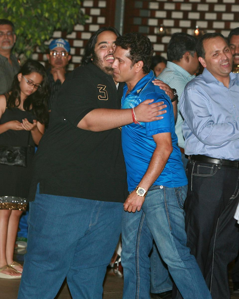 MUMBAI, INDIA ? MAY 27: Sachin Tendulkar with Mukesh Ambani's son Hari Anant at the party hosted by Nita Ambani to celebrate her team?s victory in IPL finals. (Photo by Milind Shelte/India Today Group/Getty Images)