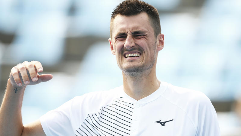 Bernard Tomic, pictured here feeling the heat and grimacing at the Australian Open.