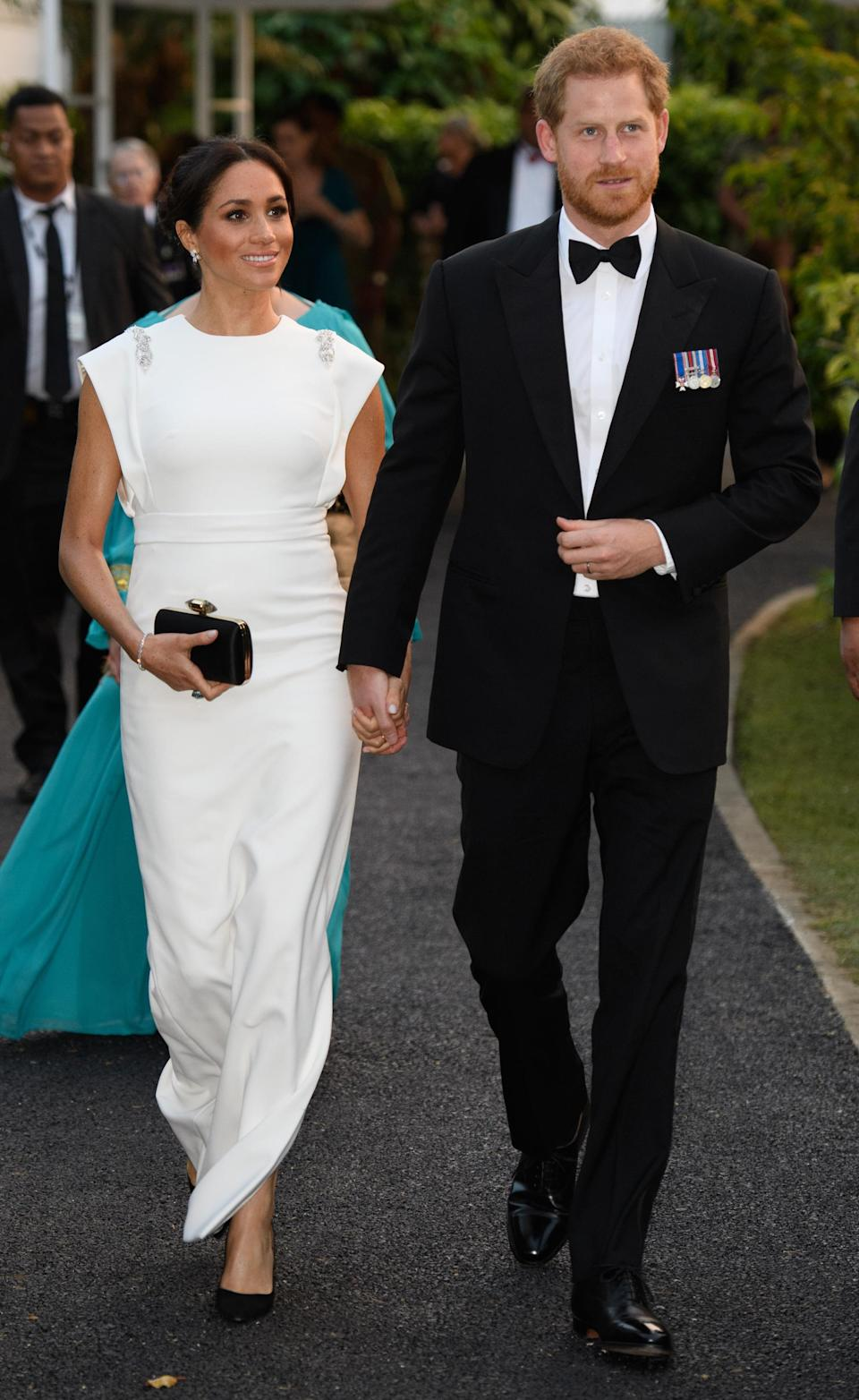 <p>For an evening reception in Tonga, the mother-to-be chose a white gown by Theia Couture with Aquazzura shoes, Birks earrings and her go-to Givenchy clutch. In a touching nod to Princess Diana, the Duchess finished the ensemble with the late royal's aquamarine ring. <em>[Photo: Getty]</em> </p>