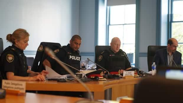 Deputy chief Uday Jaswal, second from left, has been suspended with pay since the first disciplinary charges were laid against him in March 2020.