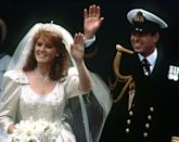 """<p>When Fergie walked down the aisle, her gown held a great deal of significance, according to the <a href=""""http://articles.latimes.com/1986-07-24/news/mn-31456_1_royal-wedding"""" rel=""""nofollow noopener"""" target=""""_blank"""" data-ylk=""""slk:Los Angeles Times"""" class=""""link rapid-noclick-resp""""><em>Los Angeles Times</em></a>. The gown itself was beaded with bees and thistles, representing the bride's coat of arms. Anchors and waves were embroidered on her veil to signify hubby Andrew's position as an officer in the Royal Navy, along with his monogram. Finally, four S's for Sarah were beaded on the bodice.</p>"""