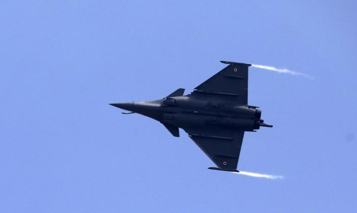 FILE - In this Thursday, Sept. 10, 2020, file photo, a French-made Rafale fighter jet flies during its induction ceremony at the Indian Air Force Station in Ambala, India. Greece's government says on Thursday, Dec. 17, 2020, it will pay 2.32 billion euros ($2.8 billion) for the purchase of French-made Rafale fighter jets and an upgrade of compatible air-to-air missile systems and part of a major military overhaul. (AP Photo/Manish Swarup, File)