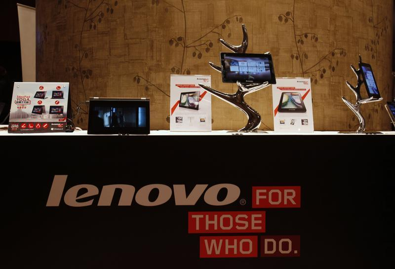 Lenovo tablets and mobile phones are displayed during a news conference on the company's annual results in Hong Kong