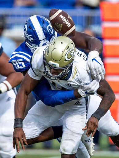Georgia Tech's James Graham (4) loses the ball after being hit by Duke's Trevon McSwain (95) during an NCAA college football game in Durham, N.C., Saturday, Oct. 12, 2019. (AP Photo/Ben McKeown)