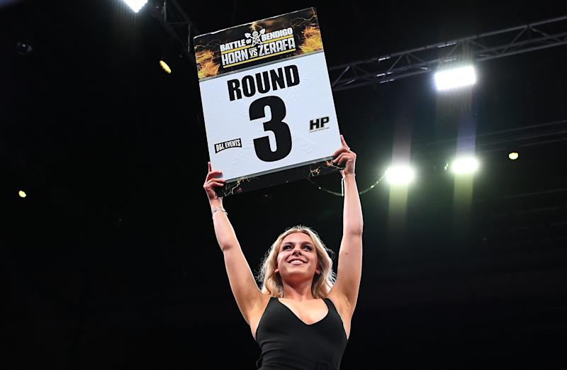 The ring girl holds up the sign during the Australian Middleweight bout between Jeff Horn and Michael Zerafa at Bendigo Stadium on August 31, 2019 in Bendigo, Australia.