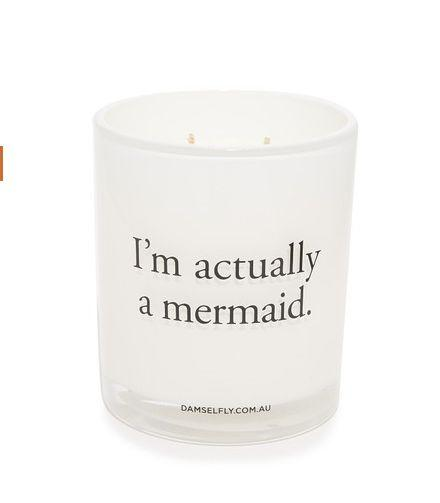 "I'm Actually A Mermaid Candle, $59, <a href=""https://www.shopbop.com/actually-mermaid-candle-damselfly/vp/v=1/1543708635.htm?fm=search-viewall-shopbysize&amp;os=false"" target=""_blank"">ShopBop</a>"