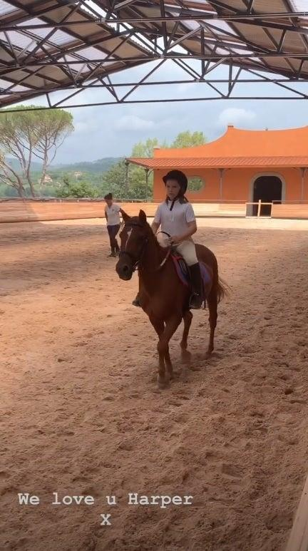 Harper Beckham is seen horse riding while on holiday in Italy with her family (@VictoriaBeckham)
