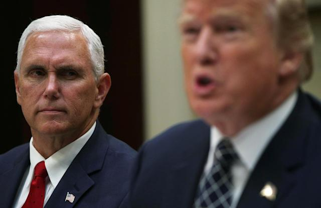 Pence listens as President Trump speaks to members of the media at the White House last month. (Photo: Alex Wong/Getty Images)