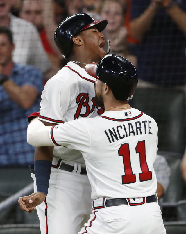 Atlanta Braves' Ronald Acuna Jr., left, and Ender Inciarte (11) celebrate after scoring on a single by Johan Camargo during the seventh inning of a baseball game against the Philadelphia Phillies on Friday, Sept. 21, 2018, in Atlanta. (AP Photo/John Bazemore)