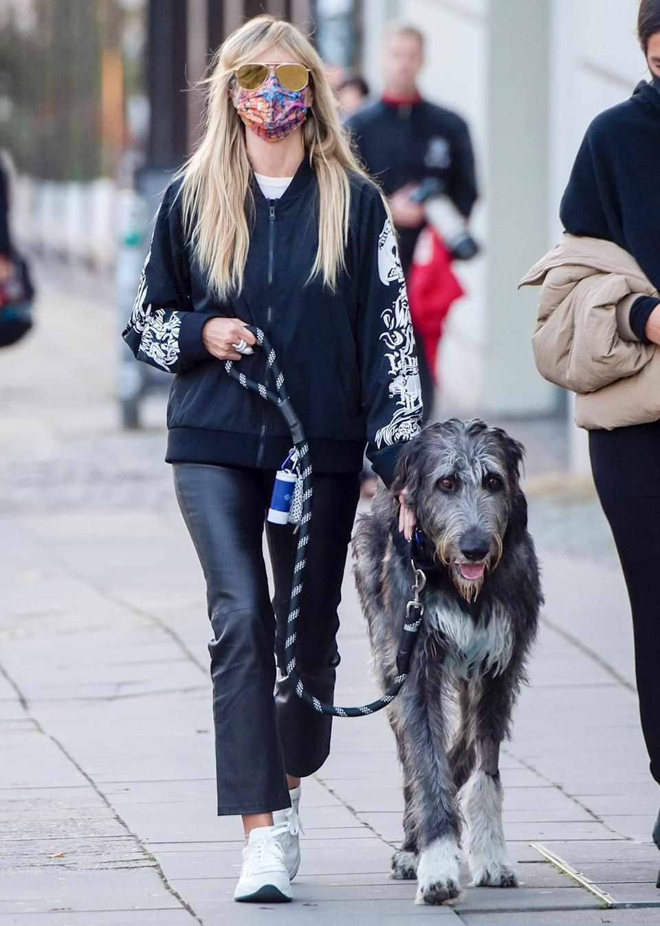 <p>Heidi Klum walks her dog through Berlin, Germany on Thursday.</p>