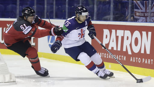 FILE - In this Sunday, May 12, 2019 file photo, Canada's Mark Stone, left, challenges Great Britain's Robert Dowd during the Ice Hockey World Championships group A match between Great Britain and Canada at the Steel Arena in Kosice, Slovakia. Ice hockey in Britain had been on a roll before the coronavirus. The Elite Ice Hockey League attendance was up. The national team broke into the top level of the world championship alongside the likes of Sweden, Russia and Canada. (AP Photo/Petr David Josek, File)