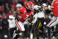 Georgia running back D'Andre Swift (7) rushes during the first half of an NCAA college football game against Missouri, Saturday, Nov. 9, 2019, in Athens, Ga. (AP Photo/John Amis)