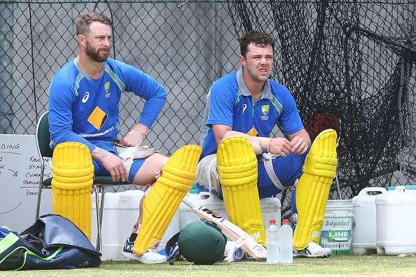 BRISBANE, AUSTRALIA - JANUARY 12: Matthew Wade and Travis Head talk during an Australian nets session at The Gabba on January 12, 2017 in Brisbane, Australia. (Photo by Chris Hyde/Getty Images)