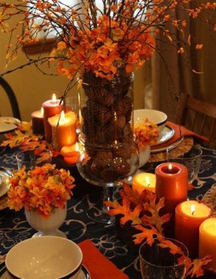 """<div class=""""caption-credit""""> Photo by: StyleCaster</div>Add warmth to your dining table with an arrangement of pinecones in a large glass jar accented with glowing candles. We especially love the explosion of orange hydrangeas around the mouth of the jar for that perfect pop of color <br> Image Via Sweet Something Designs"""
