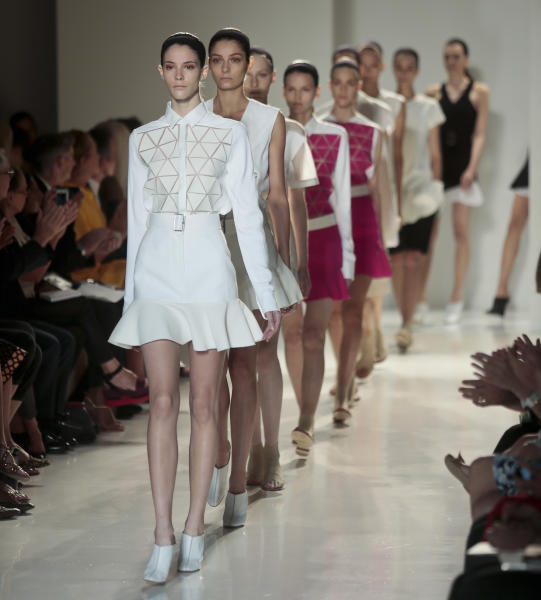 Fashion from the Victoria Beckham Spring 2014 collection is modeled on Sunday, Sept. 8, 2013 in New York. (AP Photo/Bebeto Matthews)