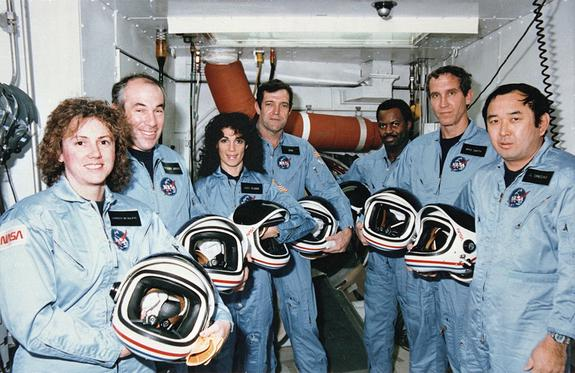 On Jan. 28, 1986, NASA faced its first shuttle disaster, the loss of the Challenger orbiter and its seven-astronaut crew. Here, Challenger's last crew – members of the STS-51L mission – stand in the White Room at Pad 39B following the end of a