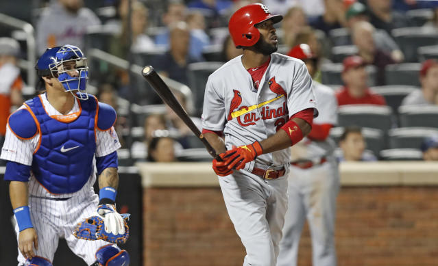 St. Louis Cardinals' Dexter Fowler watches his three-run home run, next to New York Mets catcher Wilson Ramos during the eighth inning of a baseball game Friday, June 14, 2019, in New York. (AP Photo/Kathy Willens)