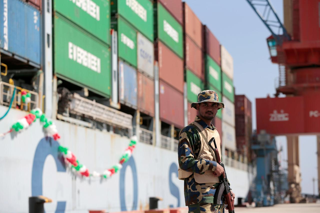 FILE PHOTO: A soldier stands guard beside the Cosco Wellington, the first container ship to depart after the inauguration of the China Pakistan Economic Corridor port in Gwadar, Pakistan November 13, 2016. REUTERS/Caren Firouz/File Photo                         GLOBAL BUSINESS WEEK AHEAD