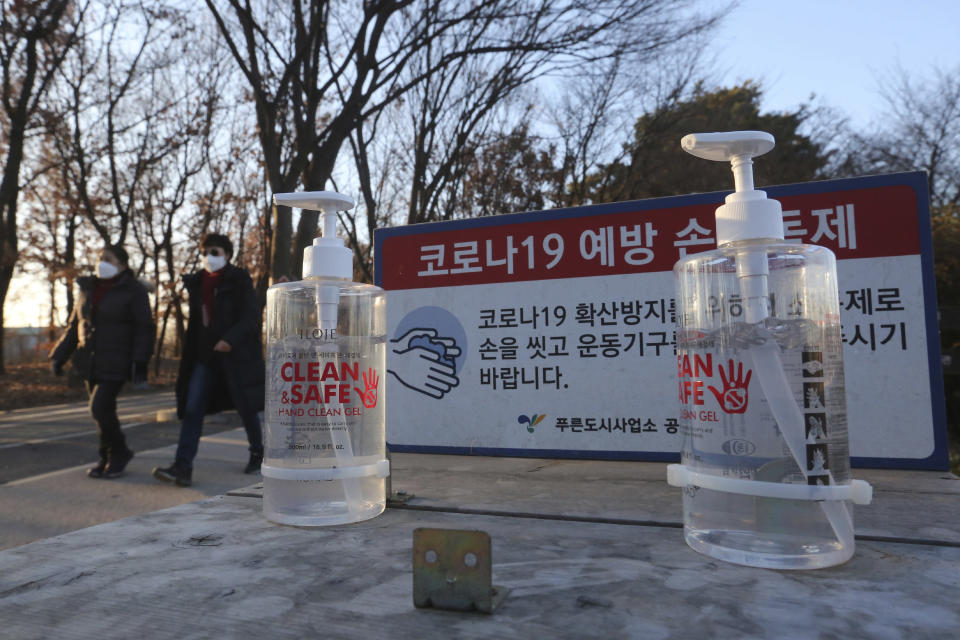 "Bottles of hand sanitizer are displayed for use at a park in Goyang, South Korea, Friday, Dec. 4, 2020. The Korea Disease Control and Prevention Agency said Friday that 600 of the newly confirmed patients were domestically transmitted cases — nearly 80 % of them in the densely populous Seoul area, which has been at the center of a recent viral resurgence. The notice reads: ""The COVID-19 prevention hand sanitizer."" (AP Photo/Ahn Young-joon)"